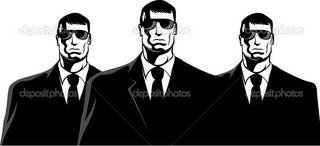 Three men in black suits. The secret service or mafia.